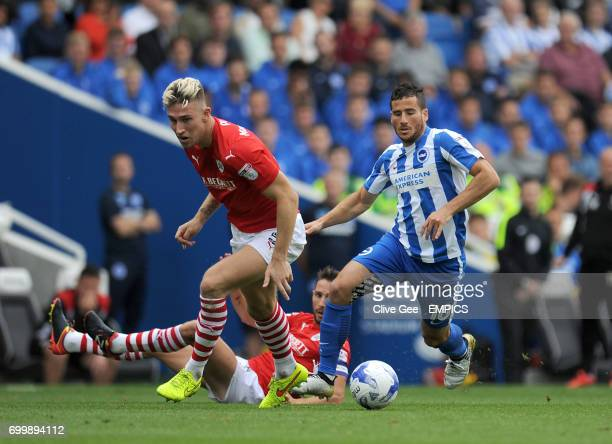 Barnsley's Angus MacDonald and Brighton Hove Albion's Tomer Hemed battle for the ball during the Sky Bet Championship match at the AMEX Stadium...