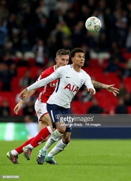 Barnsley's Angus MacDonald and Tottenham Hotspur's Dele Alli battle for the ball during the Carabao Cup third round match at Wembley Stadium London
