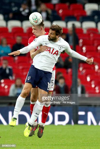 Barnsley's Angus MacDonald and Tottenham Hotspur's Fernando Llorente battle for the ball during the Carabao Cup third round match at Wembley Stadium...
