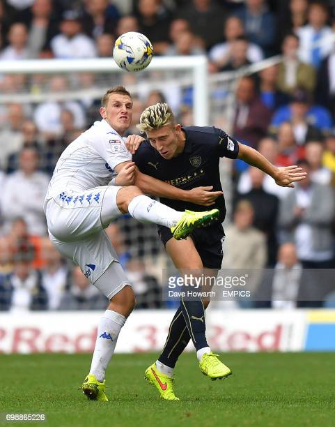 Barnsley's Angus MacDonald battles with Leeds United's Chris Wood