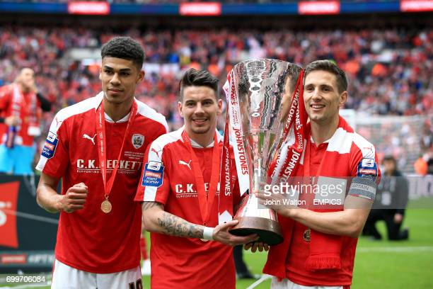 Barnsley's Ashley Fletcher Adam Hammill and Conor Hourihane celebrate with the Johnstone's Paint Trophy after the game