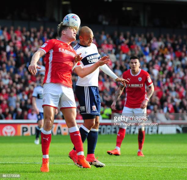 Barnsley's Cameron McGeehan vies for possession with Middlesbrough's Martin Braithwaite during the Sky Bet Championship match between Barnsley and...