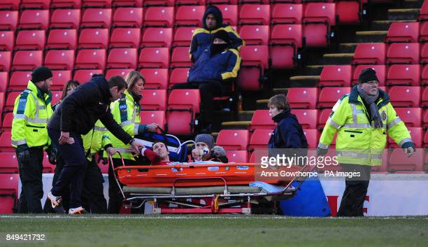 Barnsley's caretaker manager David Flitcroft talks to Jim O'Brien as he is taken off the field on a stretcher during the npower Football League...