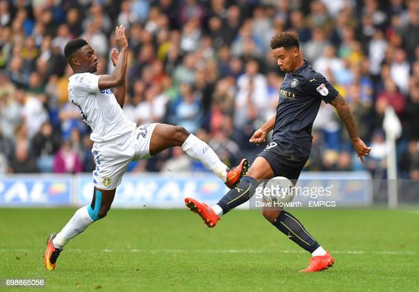 Barnsley's Cole Kpekawa battles with Leeds United's Hadi Sacko