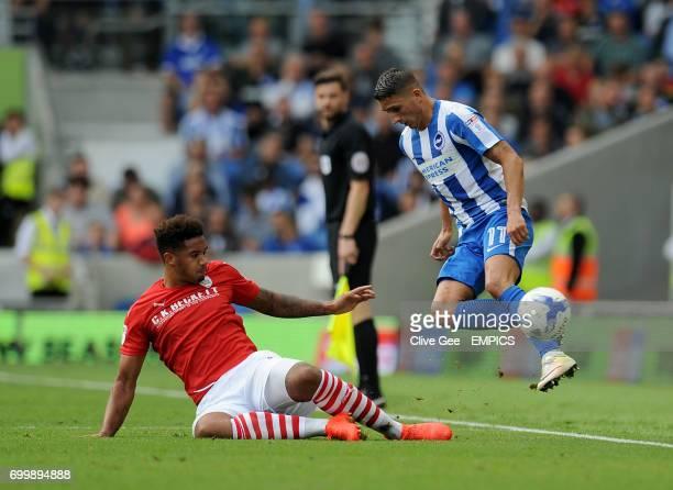 Barnsley's Cole Kpekawa slides in on Brighton Hove Albion's Anthony Knockaert during the Sky Bet Championship match at the AMEX Stadium Brighton
