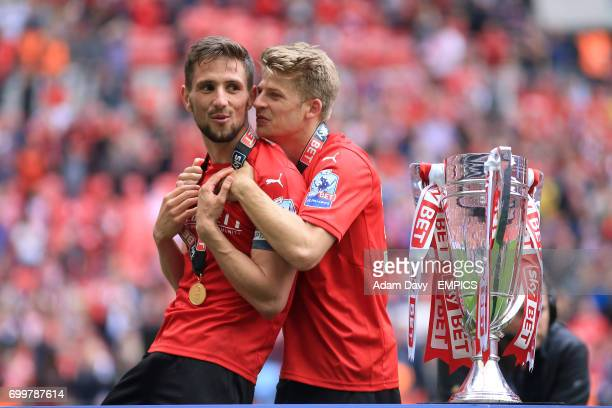 Barnsley's Conor Hourihane and Lloyd Isgrove celebrate after the game