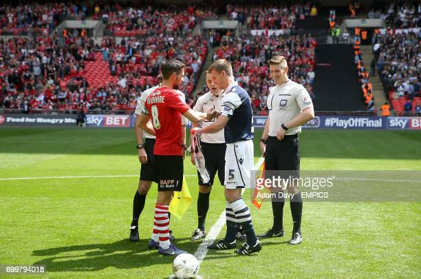 Barnsley's Conor Hourihane and Millwall's Tony Craig shake hands prior to the match