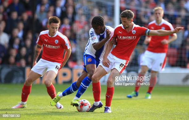 Barnsley's Conor Hourihane and Walsall's Romaine Sawyers in action
