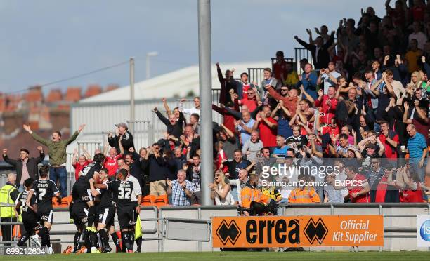 Barnsley's Conor Hourihane celebrates scoring against Blackpool with his fans