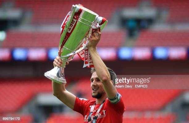 Barnsley's Conor Hourihane celebrates with the trophy