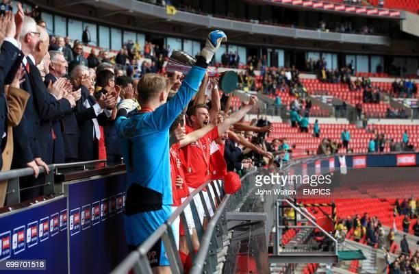 Barnsley's Conor Hourihane lifts the Johnstone's Paint Trophy at Wembley Stadium London