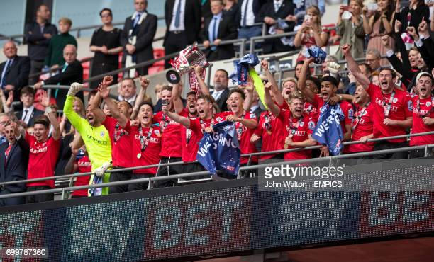 Barnsley's Conor Hourihane lifts the Sky Bet League One Play Off trophy