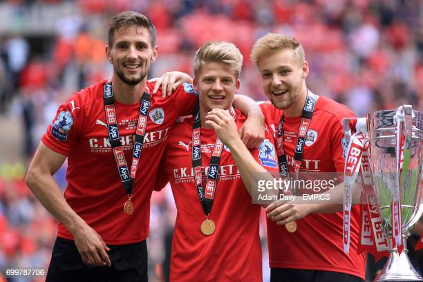 Barnsley's Conor Hourihane Lloyd Isgrove and Harry Chapman celebrate after the game