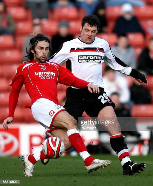 Barnsley's Daniel Bogdanovic and Charlton Athletic's Graeme Murty battle for the ball during the CocaCola Championship match at Oakwell Barnsley