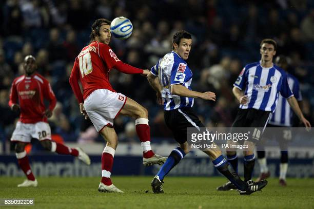 Barnsley's Daniel Bogdanovic and Sheffield Wednesday's Richard Wood battle for the ball
