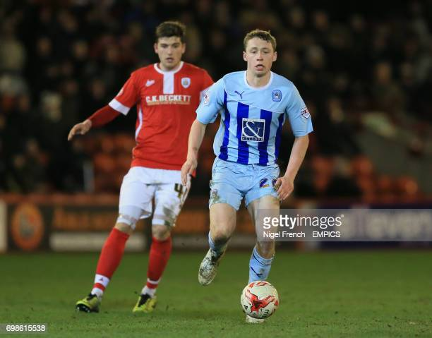 Barnsley's George Waring and Coventry City's Matthew Pennington battle for the ball