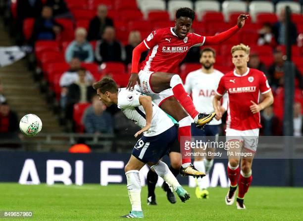 Barnsley's Ike Ugbo and Tottenham Hotspur's Harry Winks battle for the ball during the Carabao Cup third round match at Wembley Stadium London