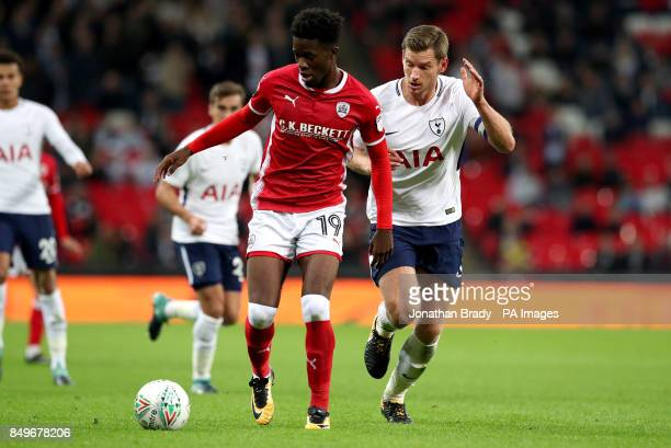 Barnsley's Ike Ugbo and Tottenham Hotspur's Jan Vertonghen battle for the ball during the Carabao Cup third round match at Wembley Stadium London