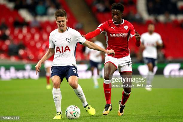 Barnsley's Ike Ugbo and Tottenham Hotspur's Juan Foyth battle for the ball during the Carabao Cup third round match at Wembley Stadium London