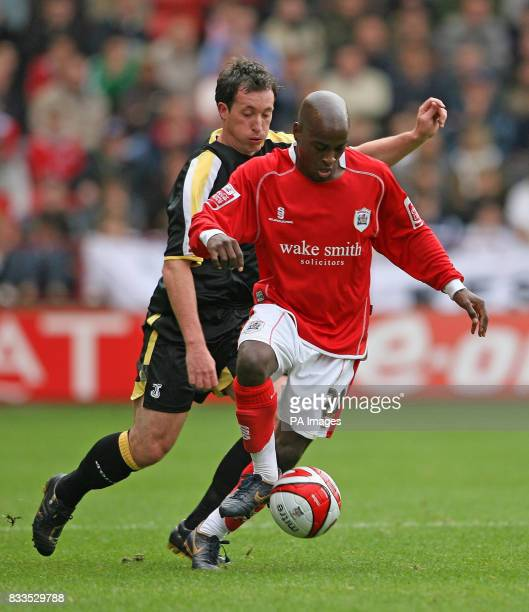 Barnsley's Jamal CampbellRyce takes on Cardiff City's Robbie Fowler during the CocaCola Football League Championship match at the Oakwell Ground...