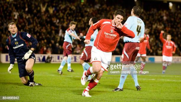 Barnsley's Jon Macken scores the opening goal during the CocaCola Football Championship match at Oakwell Barnsley