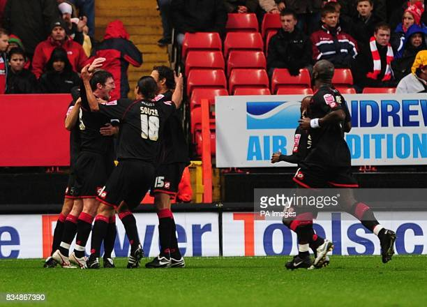 Barnsley's Jonathan Macken celebrates with his team mates after he scores his and his side's second goal of the game