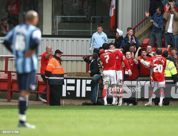 Barnsley's Jonathan Macken is congratulated by his team mates after scoring Barnsley's third
