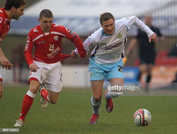 Barnsley's Kieran Tripper and Burnley's John Guidetti battle for the ball during the npower Championship match at Oakwell Barnsley