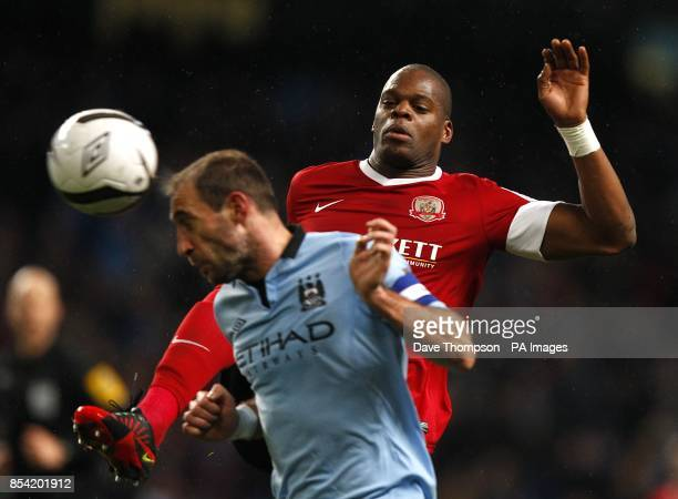 Barnsley's Marlon Harewood and Manchester City's Pablo Zabaleta battle for the ball
