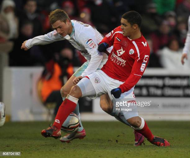 Barnsley's Nathan Doyle and Burnley's John Guidetti during the npower Championship match at Oakwell Barnsley
