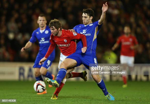 Barnsley's Paddy McCourt and Leicester City's Matty James battle for the ball during the Sky Bet Championship match at Oakwell Barnsley