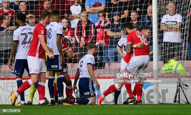 Barnsley's Tom Bradshaw right celebrates scoring the opening goal with teammate Adam Jackso during the Sky Bet Championship match between Barnsley...