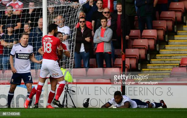 Barnsley's Tom Bradshaw right celebrates scoring the opening goal with teammate Adam Jackson during the Sky Bet Championship match between Barnsley...