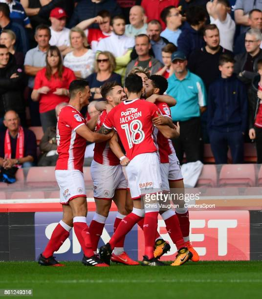 Barnsley's Tom Bradshaw second in from left celebrates scoring the opening goal with teammates during the Sky Bet Championship match between Barnsley...