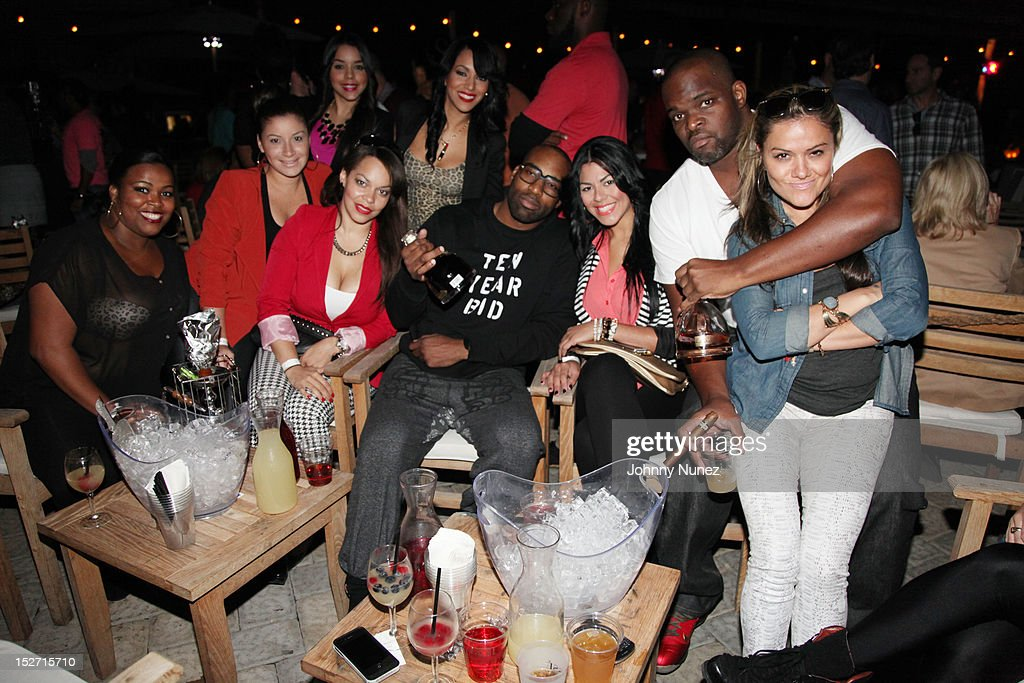 <a gi-track='captionPersonalityLinkClicked' href=/galleries/search?phrase=Baron+Davis&family=editorial&specificpeople=201592 ng-click='$event.stopPropagation()'>Baron Davis</a> (C) and guests attend the Jay-Z And Beyonce Summer Ends With D'USSE Cognac Cocktails Celebration at La Marina Restaurant Bar Beach Lounge on September 23, 2012 in New York City.