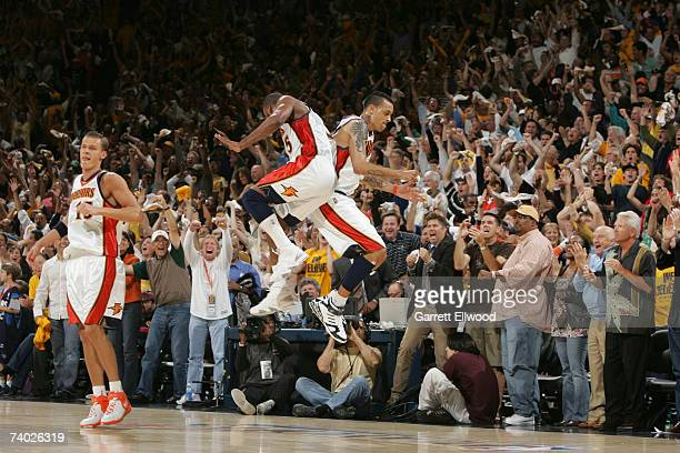 Baron Davis and Matt Barnes of the Golden State Warriors celebrates against the Dallas Mavericks in Game Four of the Western Conference Quarterfinals...