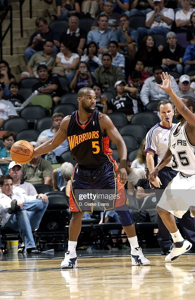Baron Davis #5 of the Golden State Warriors handles the ball during the preseason game against the San Antonio Spurs on October 18th at AT&T Center in San Antonio, Texas. The Spurs won 116-111.