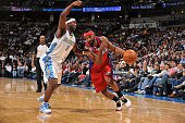 Baron Davis of the Los Angeles Clippers goes to the basket against Ty Lawson of the Denver Nuggets on January 21 2010 at the Pepsi Center in Denver...