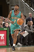 Baron Davis of the New Orleans Hornets brings the ball upcourt during the game against the Seattle Sonics at Key Arena on December 20 2002 in Seattle...