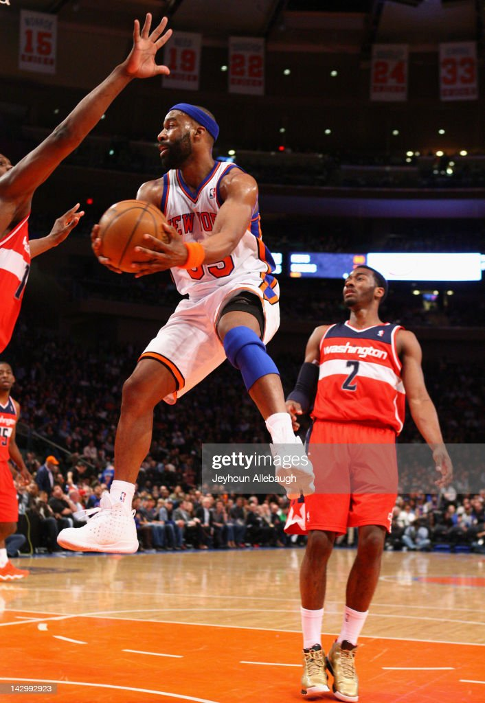 <a gi-track='captionPersonalityLinkClicked' href=/galleries/search?phrase=Baron+Davis&family=editorial&specificpeople=201592 ng-click='$event.stopPropagation()'>Baron Davis</a> #85 of the New York Knicks jumps in the air as he attempts to pass the ball during the game against the Washington Wizards on April 13, 2012 at Madison Square Garden in New York City.