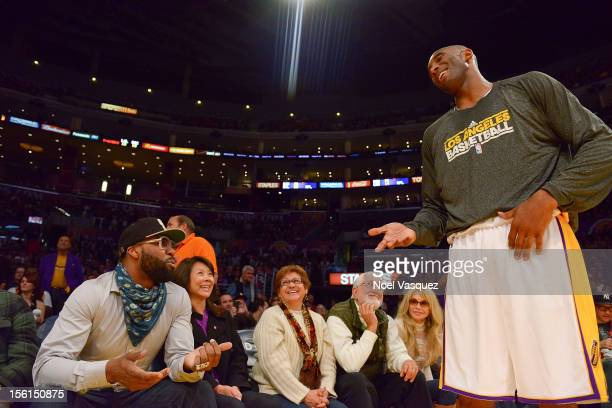 Baron Davis talk to Kobe Bryant at a basketball game between the Sacramento Kings and the Los Angeles Lakers at Staples Center on November 11 2012 in...