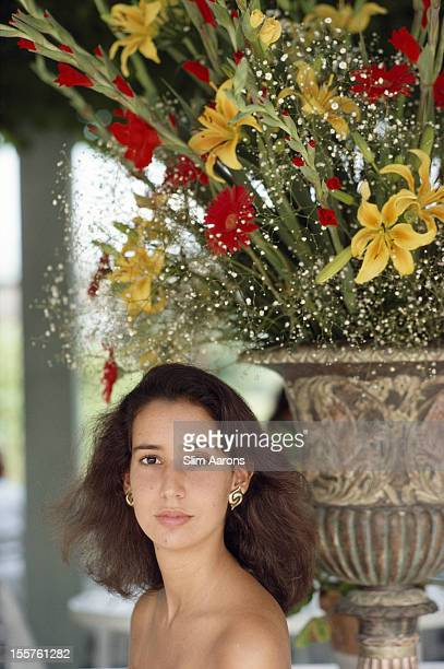 Baroness Allegra Franchetti poses beneath a display of red and yellow flowers in Asolo Italy in September 1988