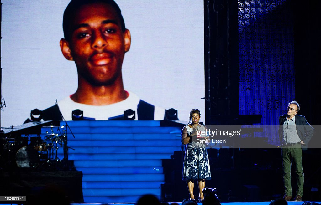 Baroness Doreen Lawrence appears on stage with Danny Boyle at the Unity concert in memory of Stephen Lawrence at O2 Arena on September 29, 2013 in London, England.