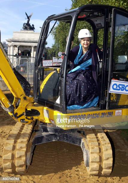 Baroness Flather Chair of the Memorial Gates Trust in a digger used for a ceremonial sodcutting at the start of the construction of the ceremonial...