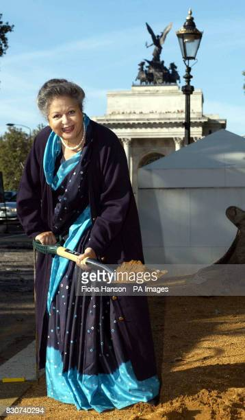 Baroness Flather Chair of the Memorial Gates Trust performs a 'ceremonial sodcutting' at the start of the construction of the ceremonial gates on...