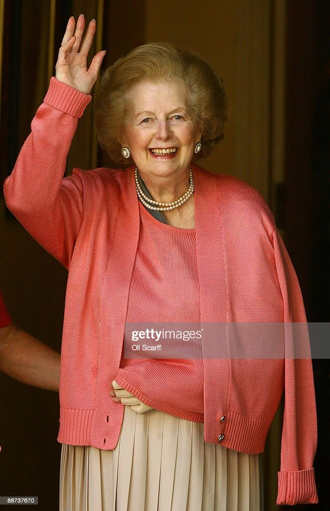 Baroness Thatcher waves from the front door of her home after returning from the Chelsea and Westminster Hospital following an operation on her broken arm on June 29, 2009 in London, England. The former Prime Minister has had a pin placed in her shoulder after suffering a fall at home two weeks ago.