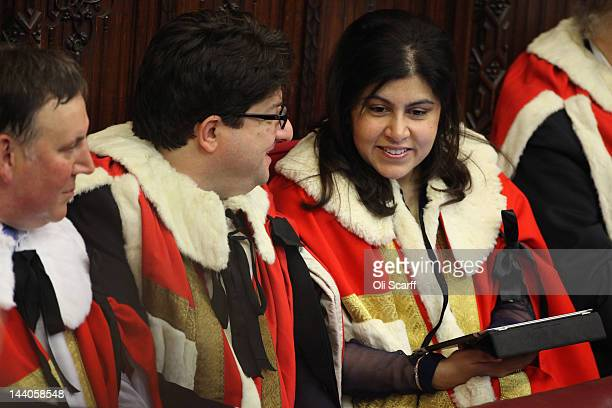 Baroness Warsi uses an iPad in in the House of Lords as he waits for the arrival of Queen Elizabeth II and Prince Philip the Duke of Edinburgh to...