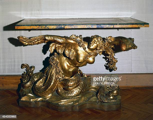Baroque style carved and gilt walnut console table with Naiad figure antique yellow marble top Italy 17th century Roma Museo Capitolino