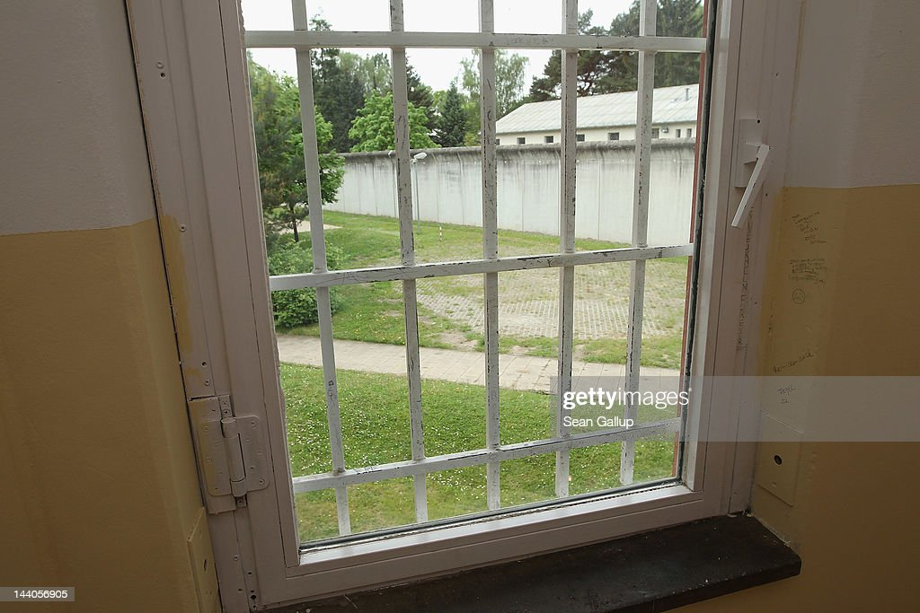 A barred cell block window looks out onto a yard and perimeter wall at the expanded youth arrest facility in Lichtenrade district on May 9, 2012 in Berlin, Germany. The facility, whose capacity is now nearly doubled, accomodates young men and women first-time offenders for short periods of time with the intent of giving them an impression of what prison is like yet to also give them a second chance at returning to freedom.