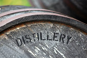 Distillery is printed on the end of this old barrel.